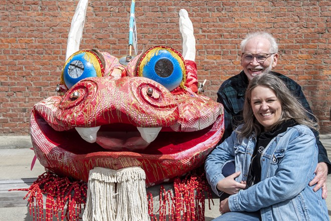 Marc and Jill Lawrence pose with the dragon Marc created for an Earth Day parade in 2000. - ZACH WILKINSON / INLAND 360