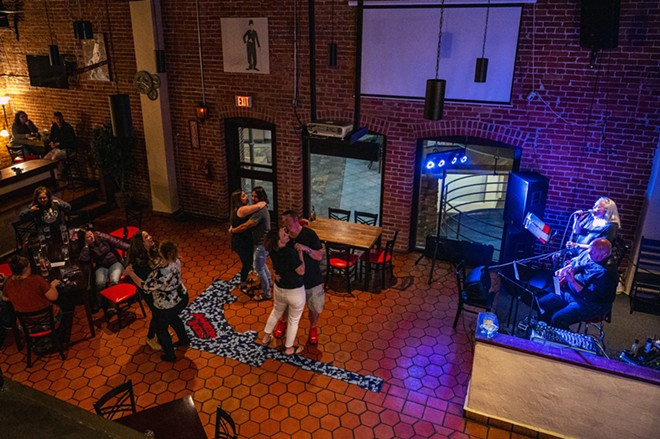 Patrons at Brock's dance while Sherry and Marty Lukenbill perform on Friday, April 23, in downtown Lewiston. - PETE CASTER/360