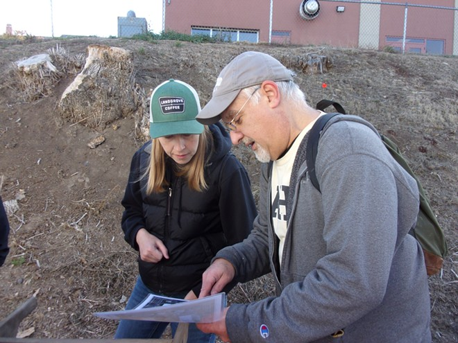 Mark Warner discusses the excavation plan at Moscow High School with site visitor and fellow University of Idaho employee and MHS alum Kim Salisbury. - MARK WARNER