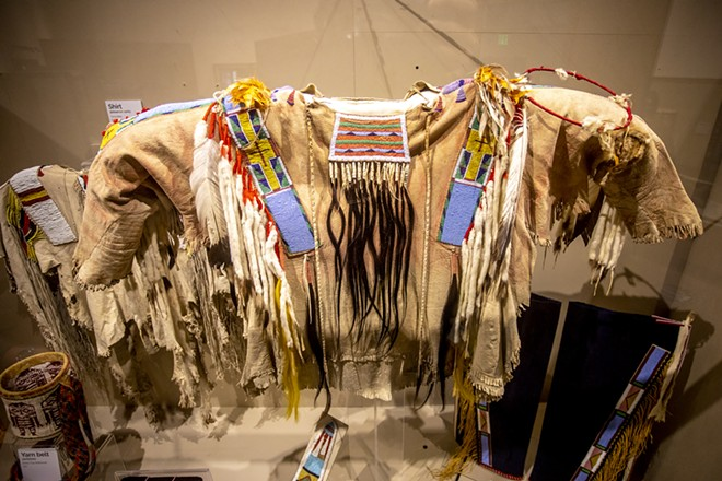 A shirt from around 1880-1885 made of buckskin, hair, glass beads, ermines, feathers, wool and silk is on display along with items from the Spalding-Allen Collection at the Nez Perce National Historical Park in Spalding. It's part of a new exhibit created for the upcoming Renaming Ceremony when the collection will be formally welcomed back by the tribe. - AUGUST FRANK
