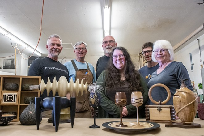 From left: Virgil Aurand, Ed Krumpe, Jim Christiansen, Amelia Trejo, Ben Carpenter and Stephanie Miller pose for a picture in front of a collection of wooden art that they've made as members of Palouse Woodworkers Collaborative. - ZACH WILKINSON/360