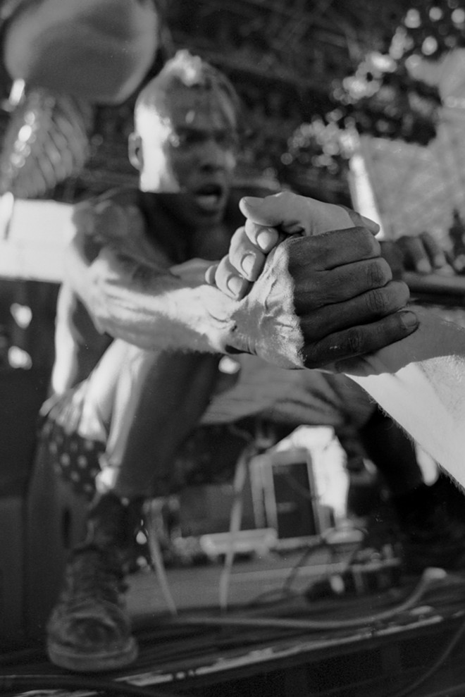 Angelo Moore, frontman for the band Fishbone, reaches out from the stage at The Gorge Amphitheater to grab a fan's hand in this 1993 photo by Darren Balch. Balch credits his experiences in Pullman for setting him on his path to becoming a rock and roll photographer. - DARREN BALCH
