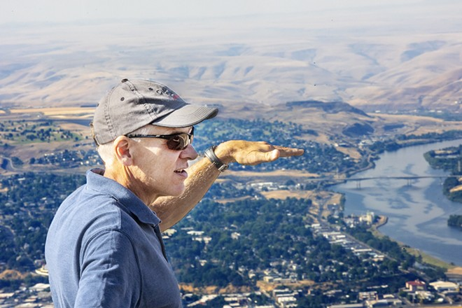 """Keegan Schmidt discusses the geology of the Lewis-Clark Valley at the top of the Lewiston Grade on Thursday. Schmidt is one of the authors of the book """"Roadside Geology of Idaho."""" - AUGUST FRANK/360"""