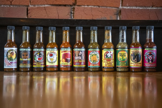 Eleven of the 18 total flavors of Irish Spike's Unique Hot Sauces. - ZACH WILKINSON/INLAND 360