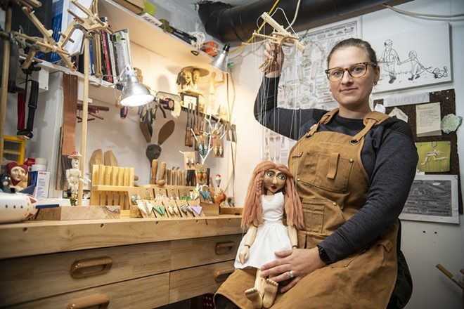 """Artist Jana Vrtelova Holbert holds Angel, her favorite of the marionettes she has carved, as she poses for a photo last month in her work studio. """"It is very relaxing. You're making something that's going to be here forever. I've never met my grandfather but I have his work and sketches to live through him,"""" said Holbert. - ZACH WILKINSON / INLAND 360"""