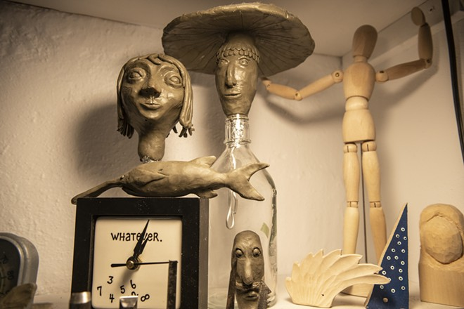 """Concept art made from plasticine sits in a corner of Holbert's studio. Holbert said that she likes to use the """"adult Play-Doh"""" prior to hand-carving a new piece to help her visualize the final product. - ZACH WILKINSON / INLAND 360"""