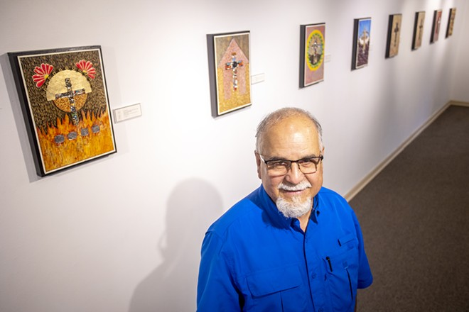 Ray Esparsen stands in front of his artwork for a portrait at the Lewis-Clark State Center for Arts & History exhibit as part of the Beautiful Downtown Lewiston's annual Artwalk. - AUGUST FRANK/360