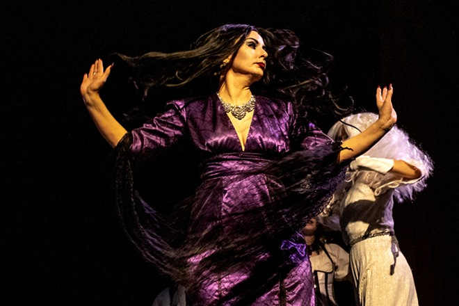 Amy Stout, playing Morticia Addams, spins around as she dances during a rehearsal for the Addams Family at the old Lewiston High School on Monday evening. - AUGUST FRANK/360