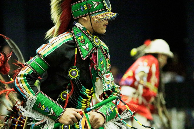 14 year old Ardon McDonald, of the Salish Tribe and Blackfeet Nation, dances. - YOUNG KWAK