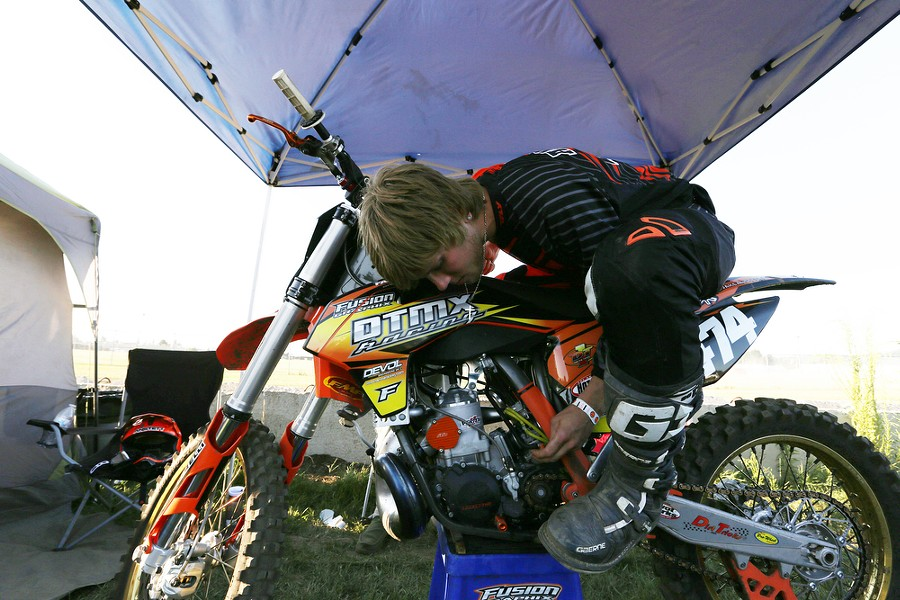 250 cc pro rider Jake Anstett, from Port Angeles, Wash., does last minute tuning on his KTM before the 14th Annual Moto X. - YOUNG KWAK