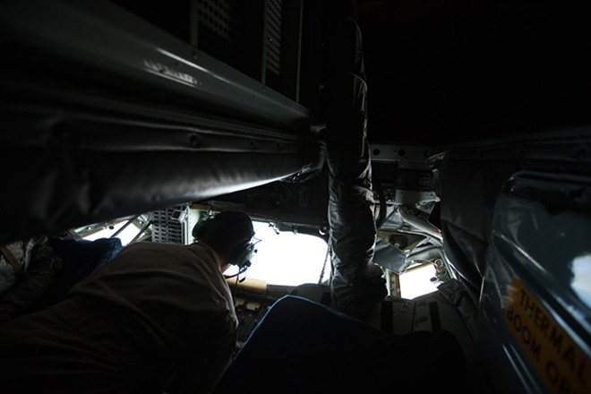376th Expeditionary Operations Group Boom Operator Senior Airman Dave Fernandez refuels an F-16 from a KC-135. - YOUNG KWAK
