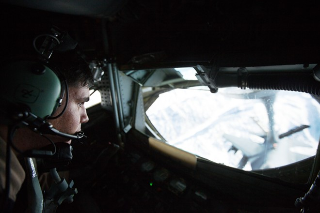 Boom Operator Senior Airman Dave Fernandez, of the 376th Expeditionary Operations Group, refuels an F-16 from a KC-135 over northern Afghanistan on Dec. 14. Fernandez's home unit is based at Fairchild Air Force Base. - YOUNG KWAK