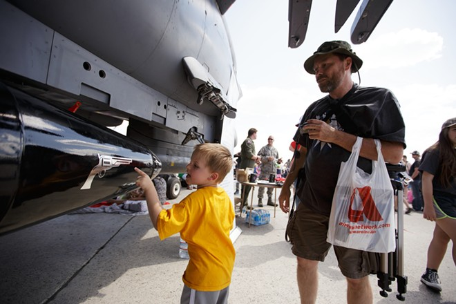 Four-year-old Hunter Frein, left, inspects an F-15E as his grandfather James looks on. - YOUNG KWAK