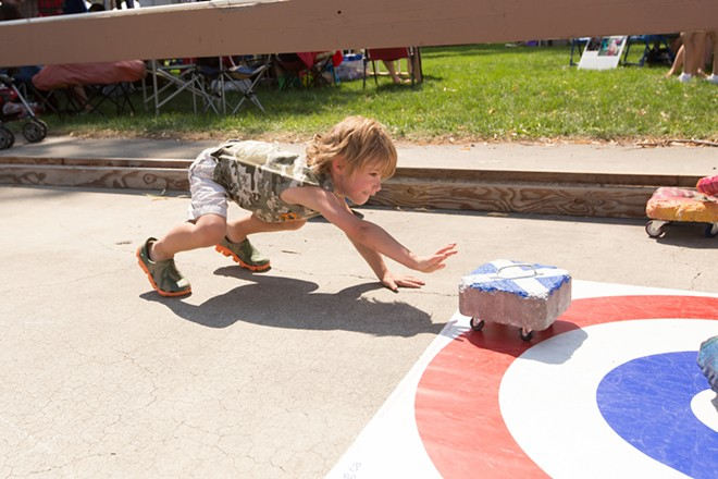 Four-year-old Malachi Begg Gilstrap curls. - YOUNG KWAK