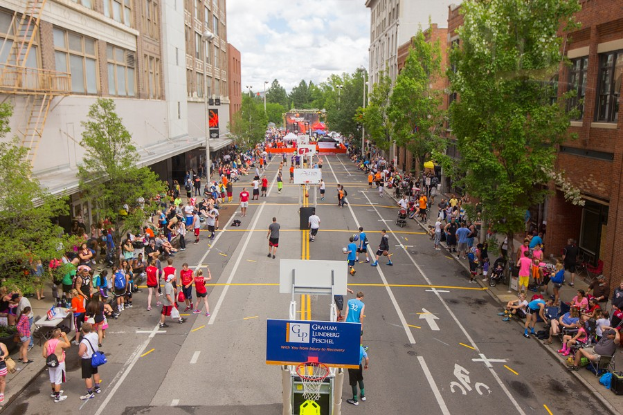Forty-two city blocks were blocked off for the 25th anniversary of Hoopfest, including Howard Street. - MATT WEIGAND