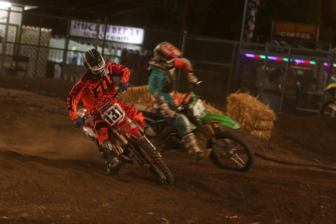 450 cc pro riders Noah McConahy (131), from Spokane, Wash., and Collin Jurin (476), from Monroe, Wash., take a turn in a Moto 2 race. - YOUNG KWAK