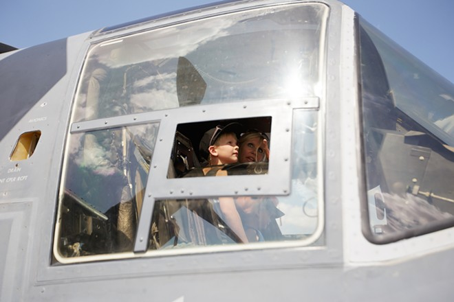 Six-year-old Gracin Siegel, left, and her mother Staci sit in the cockpit of a V-22 Osprey. - YOUNG KWAK