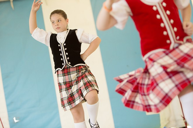 Eight-year-old Gabrilla Van Inwegen, left, and 9-year-old Elizabeth Darjany dance the Highland Fling. - YOUNG KWAK