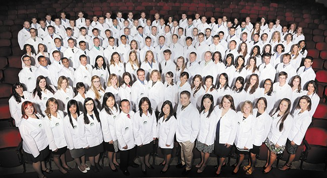 """A 2014 """"White Coat"""" ceremony at Pacific Northwest University of Health Sciences in Yakima celebrates students' future in the osteopathic profession. - RICK BAUMGARDNER"""