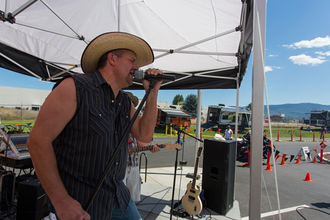 A band preforms for the crowd at Lone Wolf Harley Davidson for the Pacific Northwest Hog Rally. - MATT WEIGAND