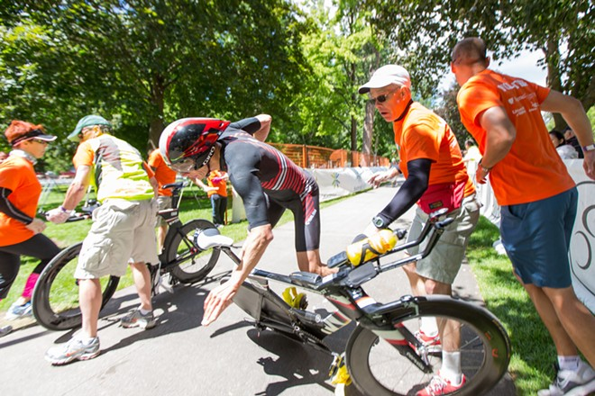 A communication error between 3-year-volunteer Brian Kingsburry, right, and a competitor resulted in a crash at the end of the bike portion. - MATT WEIGAND