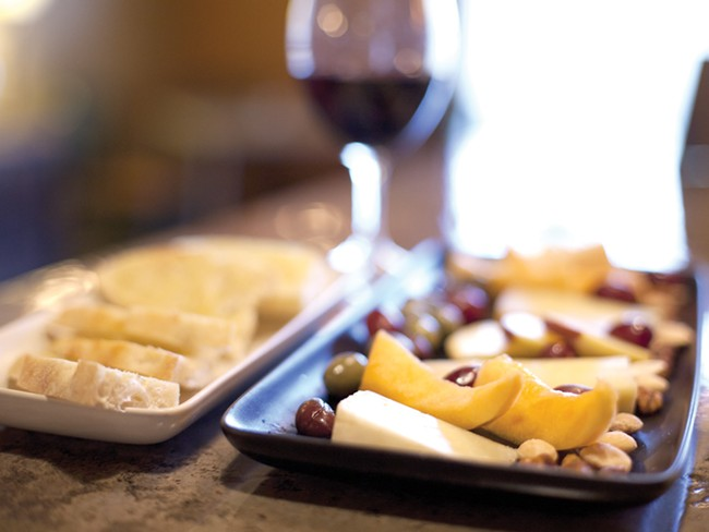 A five-cheese tray with a glass of cabernet at Mezzo Pazzo - MIKE MCCALL