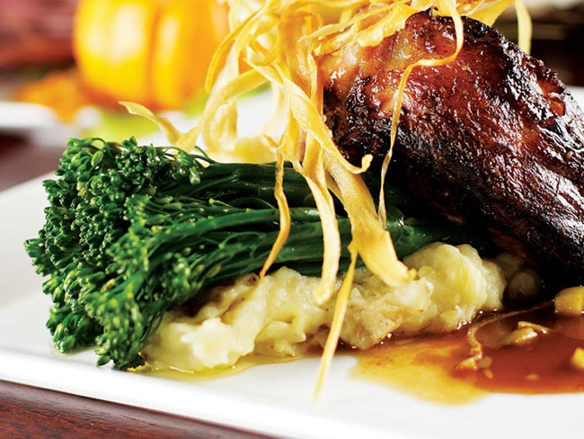 A grand cut grilled pork chop is on C.I. Shenanigan's Thanksgiving menu - YOUNG KWAK