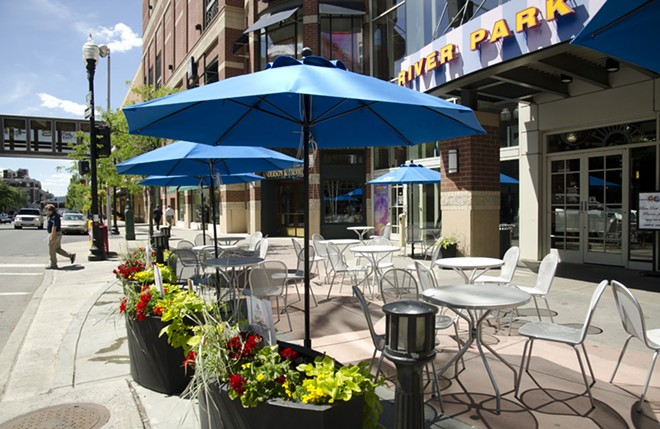 The new sidewalk cafe outside River Park Square is bordered by flower planters. - LISA WAANANEN