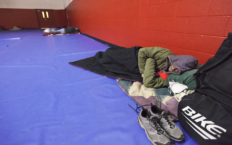 A man settles in for the night at the Salvation Army warming center in Spokane last December. The program needs volunteers to expand the service. - JACOB JONES