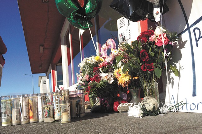 A memorial for Antonio Zambrano-Montes has become a community gathering place in Pasco. - SCOTT A. LEADINGHAM