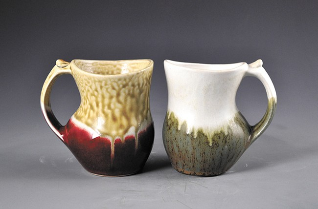 """A pair of mugs by Loren Lukens featured in Trackside Studio's """"Cup of Joy"""" show."""