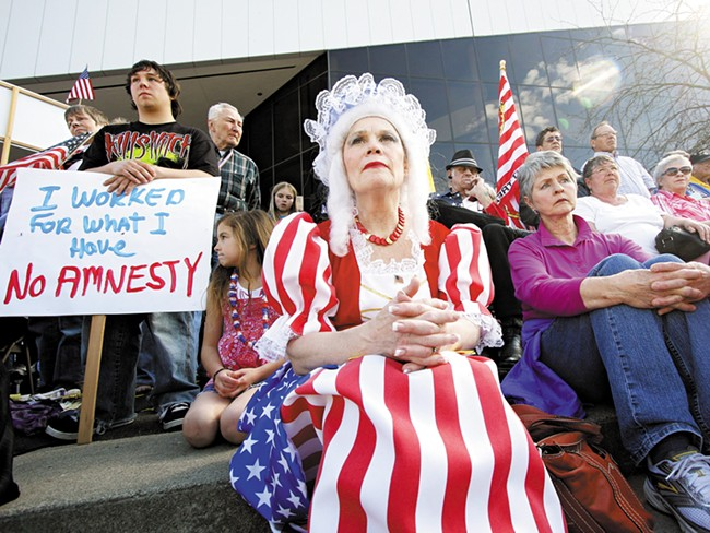 A reveler at the Tea Party in Spokane in April - YOUNG KWAK