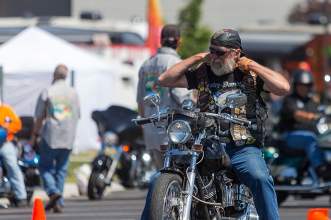 """A rider fixes his jacket before he approaches the start of the """"slow race,"""" a race where riders drive as slowly as possible on a set course. - MATT WEIGAND"""
