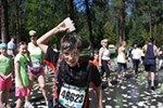 A runner dowses himself with water.