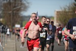 A runner heads down Broadway Avenue.