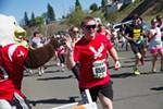 A runner receives a high five while heading up Doomsday Hill.