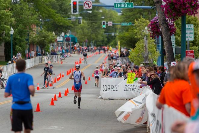 A competitor runs through downtown Coeur d'Alene for the final portion of the triathlon. - MATT WEIGAND