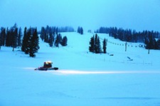 A snowcat finishes an early morning run down the hill. The snowcat will run for 36 hours straight preparing for the weekends.