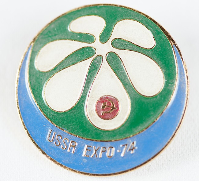 A USSR pin featuring a tiny hammer and sickle. - YOUNG KWAK