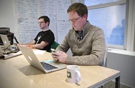 Fellow founder Luke Baumgarten, right, working dual-screen style. - LISA WAANANEN