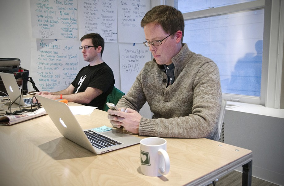 Fellow founder Luke Baumgarten, right, working dual-screen style. - LISA WAANANEN