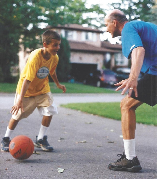 A young Kevin Pangos goes one-on-one with his dad, Bill Pangos.