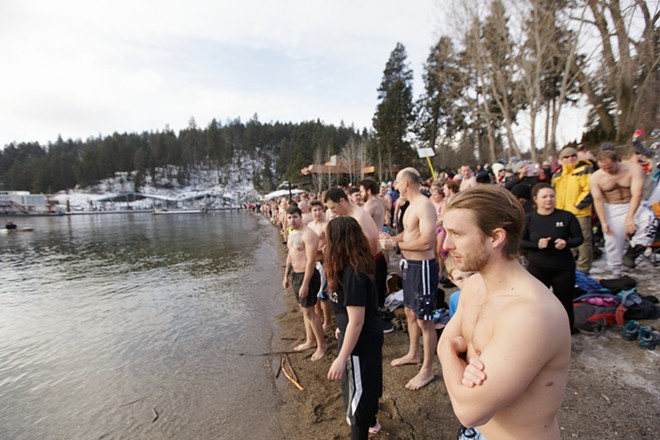 Aaron Dahlgren, right, waits for the beginning of the Polar Bear Plunge. - YOUNG KWAK