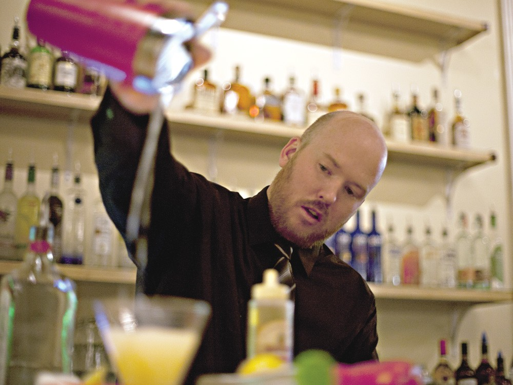 Aaron Mock prepares a pineapple mojito at the Vault Supper Club. - MIKE MCCALL