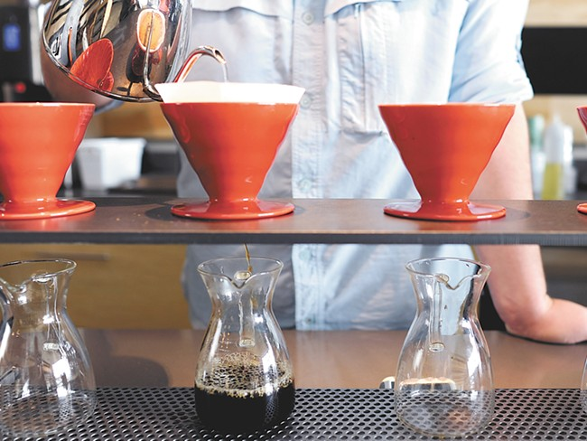 Aaron Monheim, a barista at Revel 77, makes a cup of coffee. - CHRISTIAN WILSON