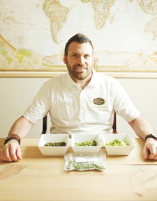 Aaron Sweatt of Fresh Nature Foods with a variety of garbanzo beans. - YOUNG KWAK
