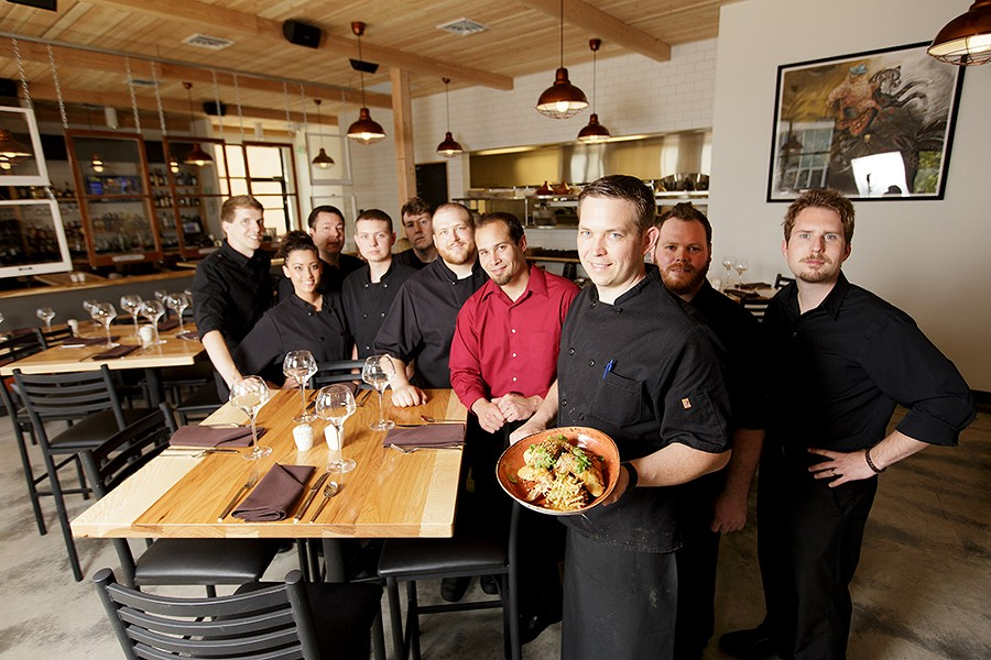 Adam Hegsted (front) as his Wandering Table staff, many of whom are his longtime friends and co-workers. - YOUNG KWAK