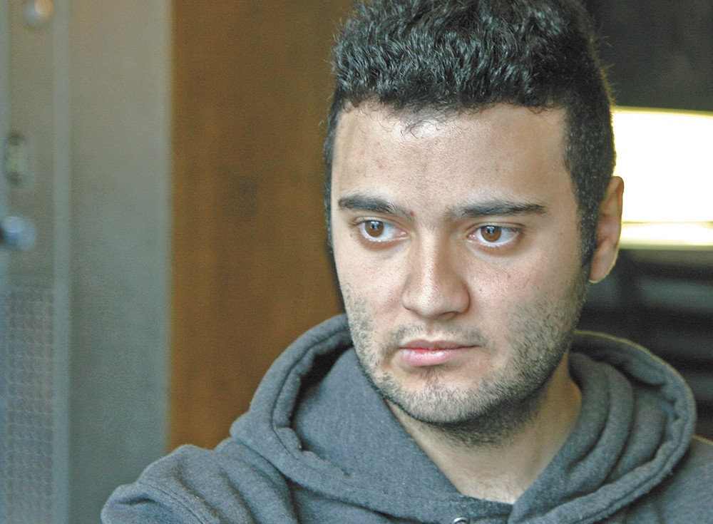 Adel Yafi, a 21-year-old student at Washington State University, once protested the Syrian regime. Now, he's watching the war from afar. - ANDREW BRADDOCK