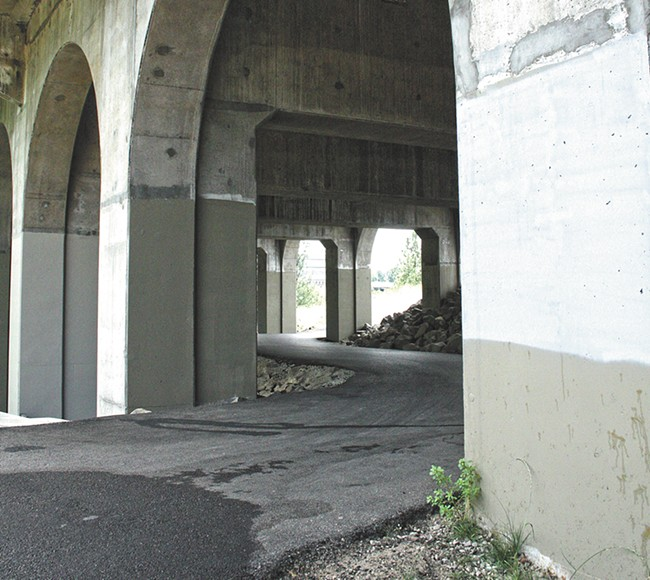 After a deadly cycling accident this month, some say new safety measures are needed on this stretch of the Centennial Trail beneath the Monroe Street Bridge. - CHRIS BOVEY