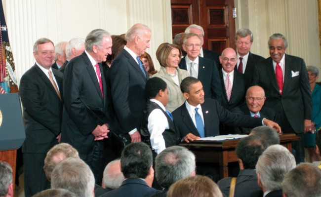 After months of debate, President Obama signed the health care reform bill in March.